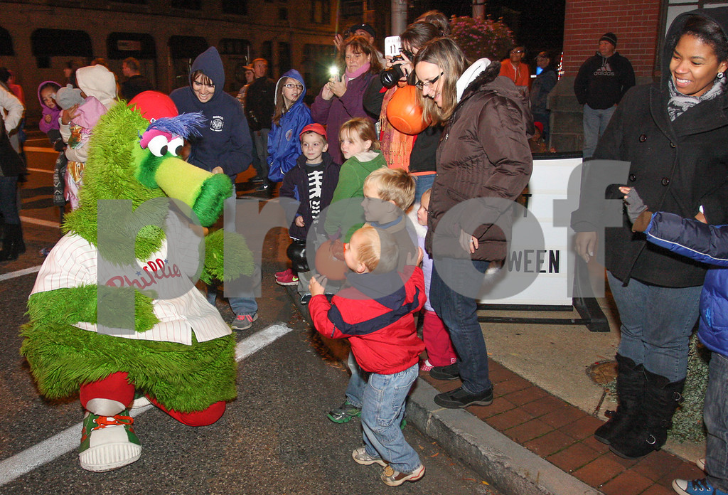 Description of . Phillie Phanatic greeted chidden along the parade route. Photo by Kevin Hoffman, the Mercury