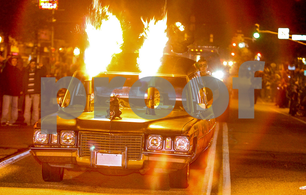 Description of . The grand finale was this fire flaming hearse. Photo by Kevin Hoffman, the Mercury