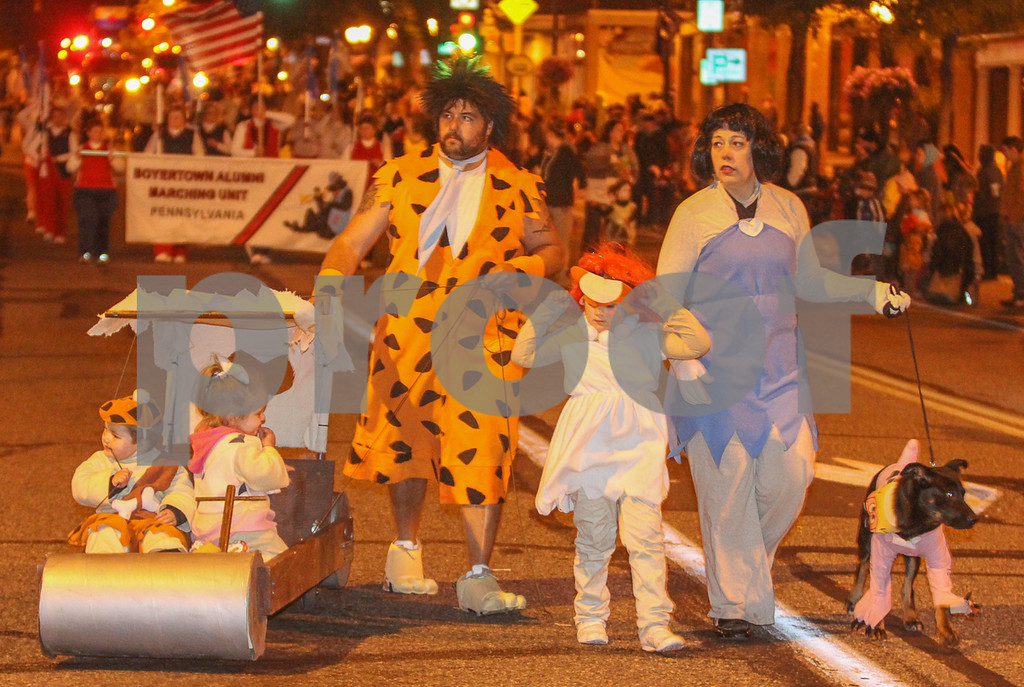 Description of . The Flintstones walked the parade route down High St. Photo by Kevin Hoffman, the Mercury