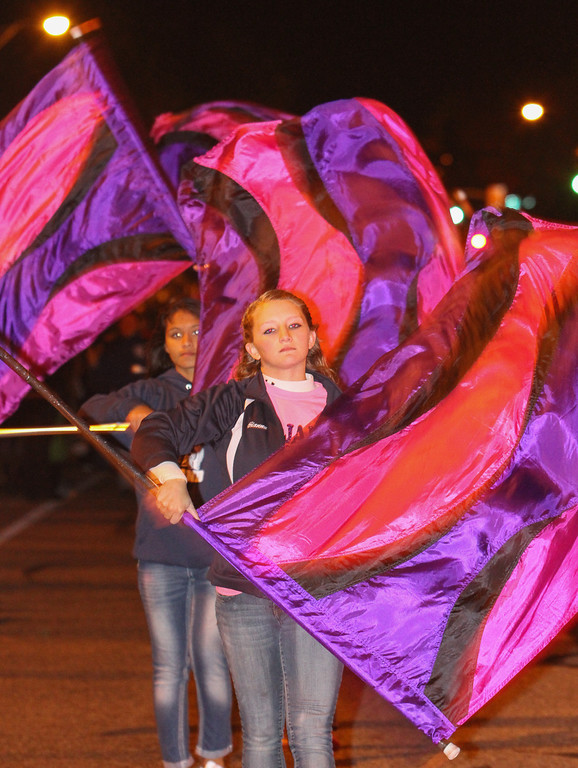Description of . Pottstown Middle School flag team twirls their colored flags. Photo by Kevin Hoffman, the Mercury
