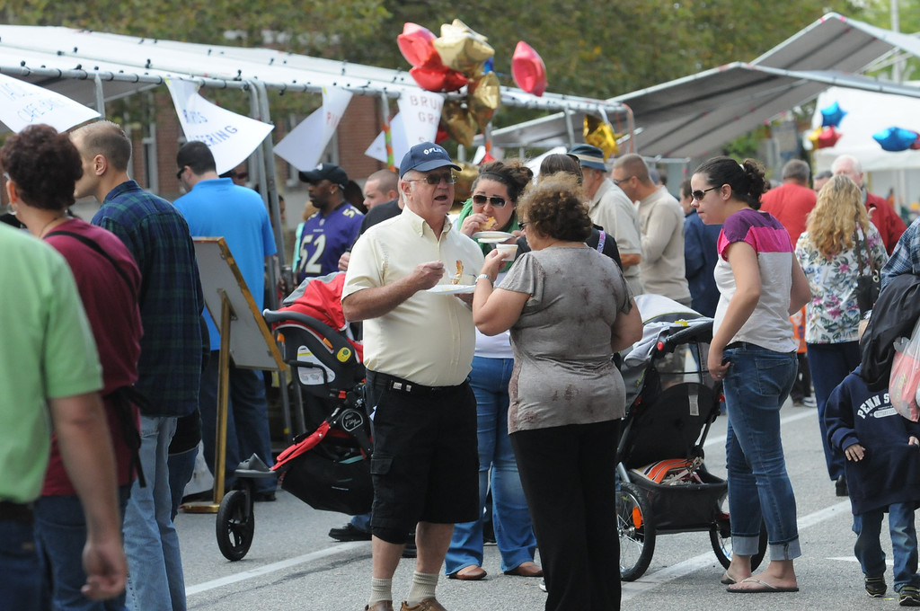 Description of . Area residents were at the Carousel of Flavor to taste samples prepared by area restaurants and catering companies Sunday in downtown Pottstown along High St. Photo by John Strickler/The Mercury