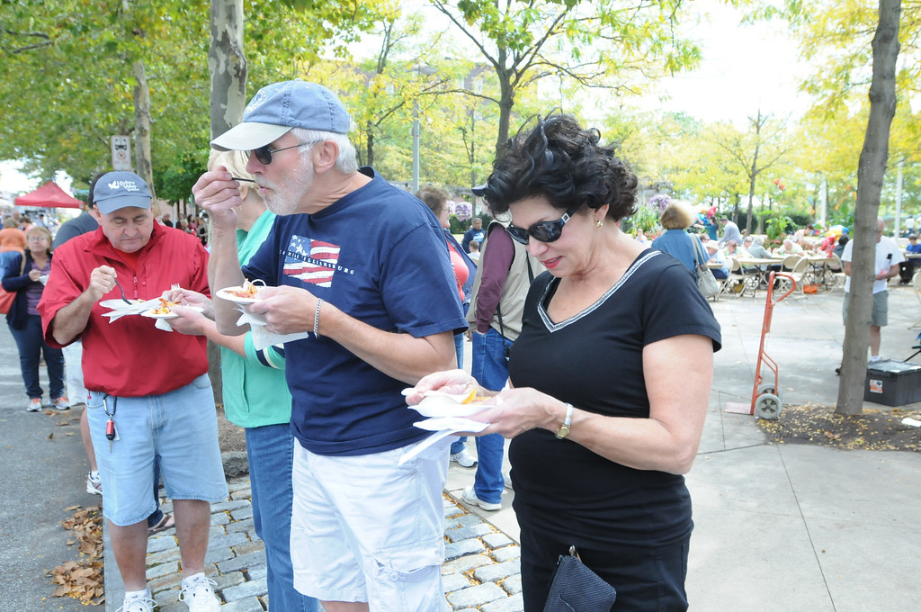 Description of . Ginny and Gene Takach along with Dave and Linda Reed were at the Carousel of Flavor to taste samples prepared by area restaurants and catering companies Sunday in downtown Pottstown along High St. Photo by John Strickler/The Mercury