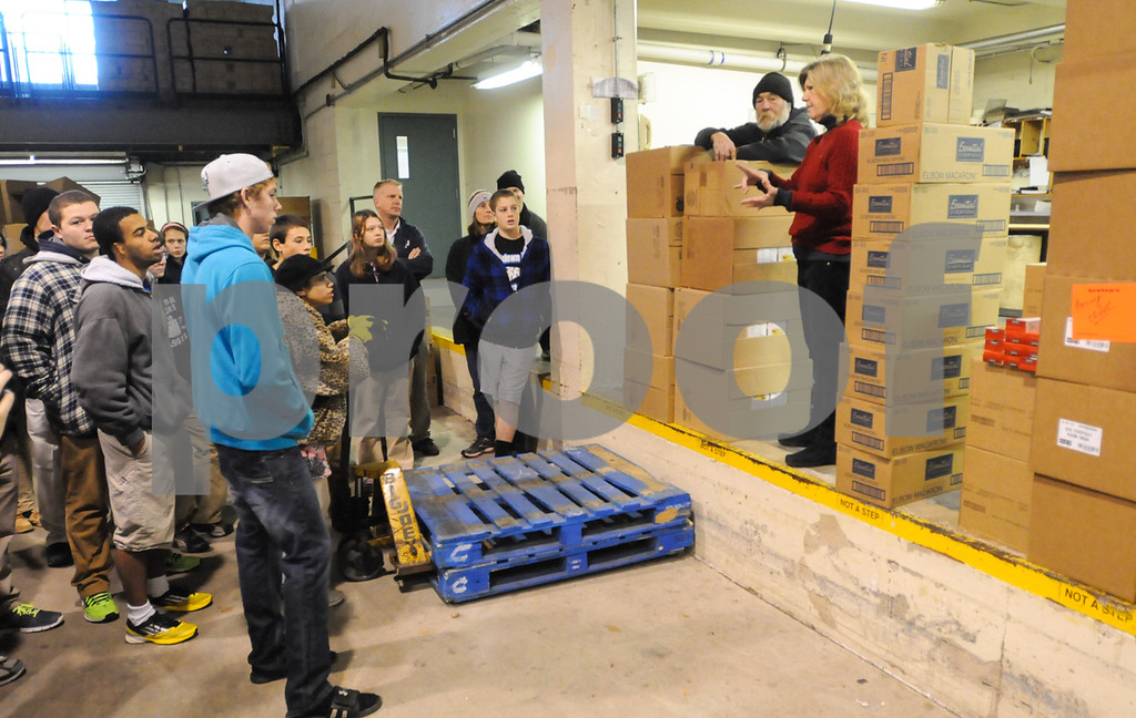 Description of . Mercury editor Nancy March speaks to Pottstown High School and Pope John Paul II students as they prepare to pack boxes of food for Operation Holiday delivery. Photo by John Strickler/The Mercury