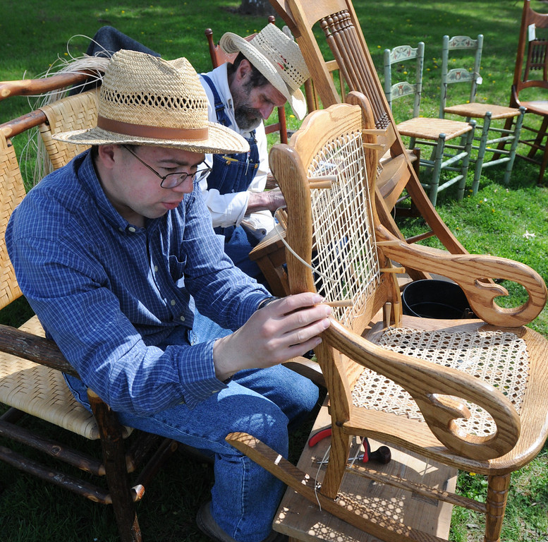 Description of . Travis Musser and Harold High do chair caning at the Colonial May Fair held at Pottsgrove Manor Saturday. Photo by John Strickler The Mercury