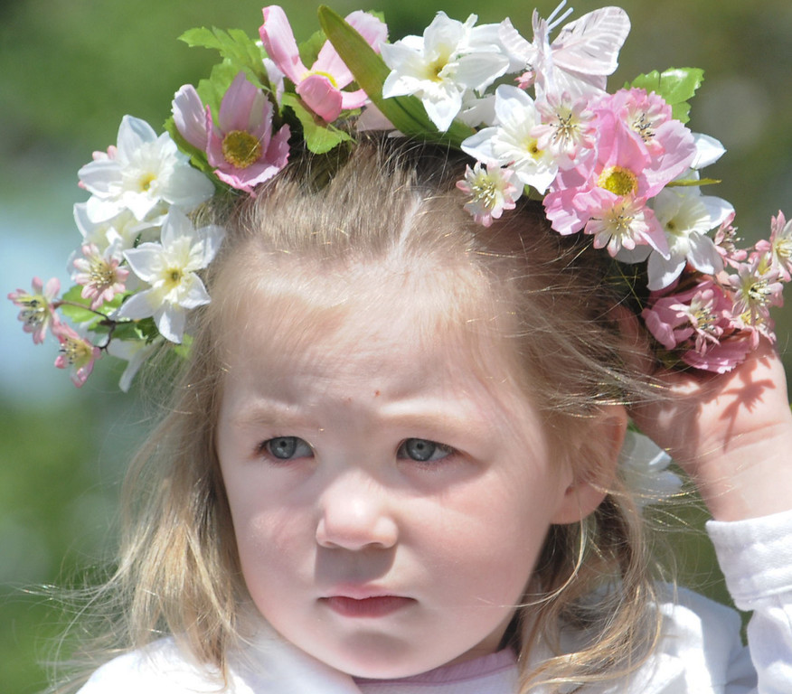 Description of . Mairead Larkin wore a flowered head piece at the Colonial May Fair held at Pottsgrove Manor Saturday. Photo by John Strickler The Mercury