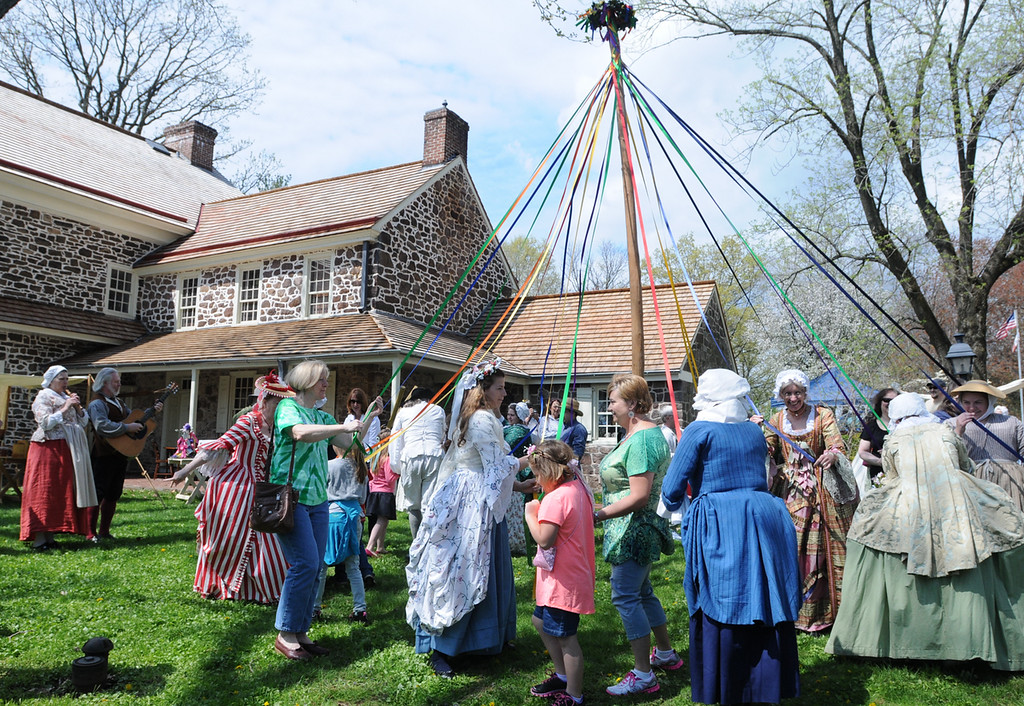Description of . Dancing around the May pole at the Colonial May Fair held at Pottsgrove Manor . Two of John Potts decendents Annette Burnett in green shirt center of photo and her daughter Skylar Christman, orange shirt both of Virginia were in Pottstown. Burnett said that John Potts is her seven times great grandfather. Photo by John Strickler The Mercury