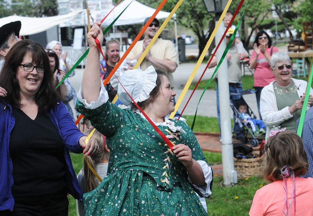 Description of . Dancing around the May pole at the Colonial May Fair held at Pottsgrove Manor Saturday. Photo by John Strickler The Mercury
