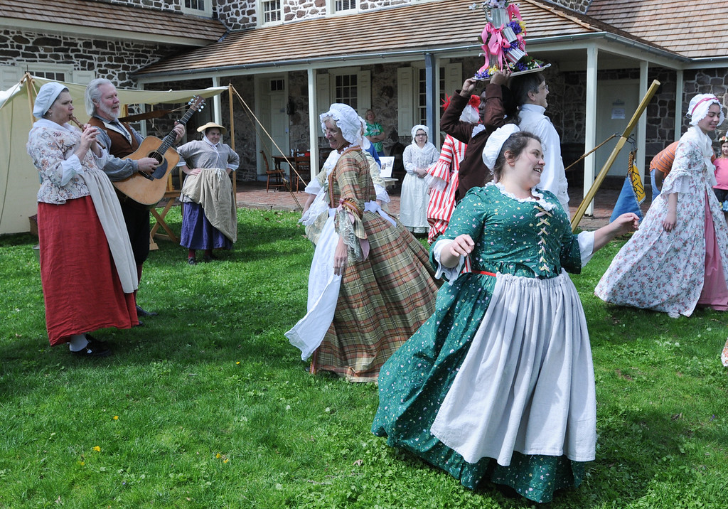 Description of . Colonial milk maiden dancing during the Colonial May Fair held at Pottsgrove Manor Saturday. Photo by John Strickler The Mercury