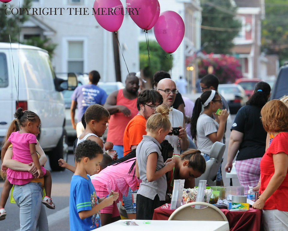 Description of . Parents and children participate in the National Night Out event held at Chestnut Street Park sponsored by Victory Christian Life Center and Genesis Housing Inc Tuesday evening. Photo by John Strickler The Mercury
