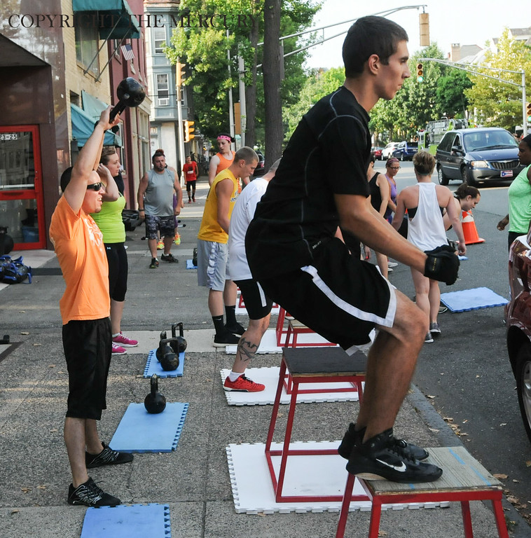 Description of . Cross Fit participated in the National Night Out with members of the gym working out on the sidewalk in front of the King Street location Tuesday evening. Photo by John Strickler The Mercury