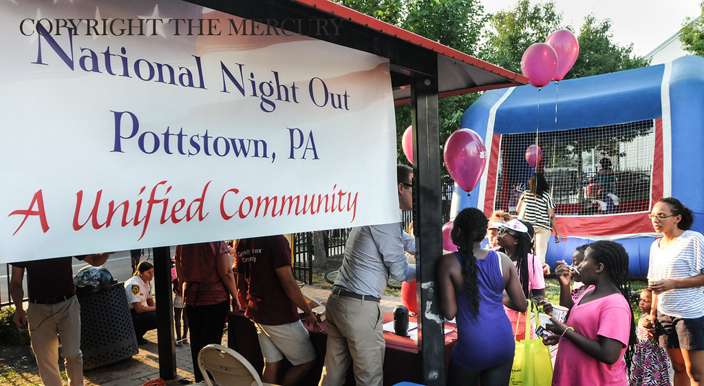 Description of . Victory Christian Life Center and Genesis Housing Inc. teamed up for National Night Out event held at the Chestnut Street Park with a sign stating that Pottstown is a Unified Community. Photo by John Strickler The Mercury