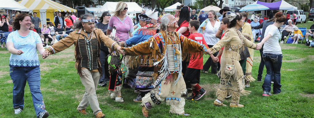 Description of . Native American dancers invited onlookers attending the pow wow to perform a round dance together. Photo by John Strickler The Mercury