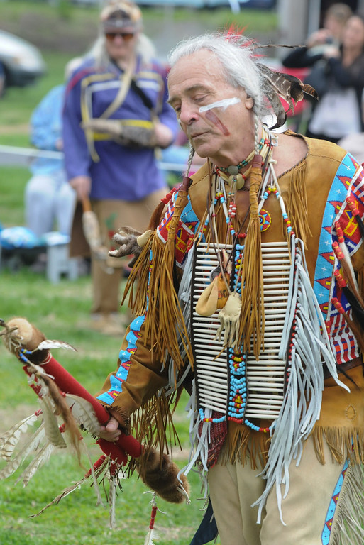 Description of . Johnny White Bull whose spirit is with the Cheyene nation takes part in men's traditional dance during the pow wow held at Memorial Park Saturday. Photo by John Strickler The Mercury