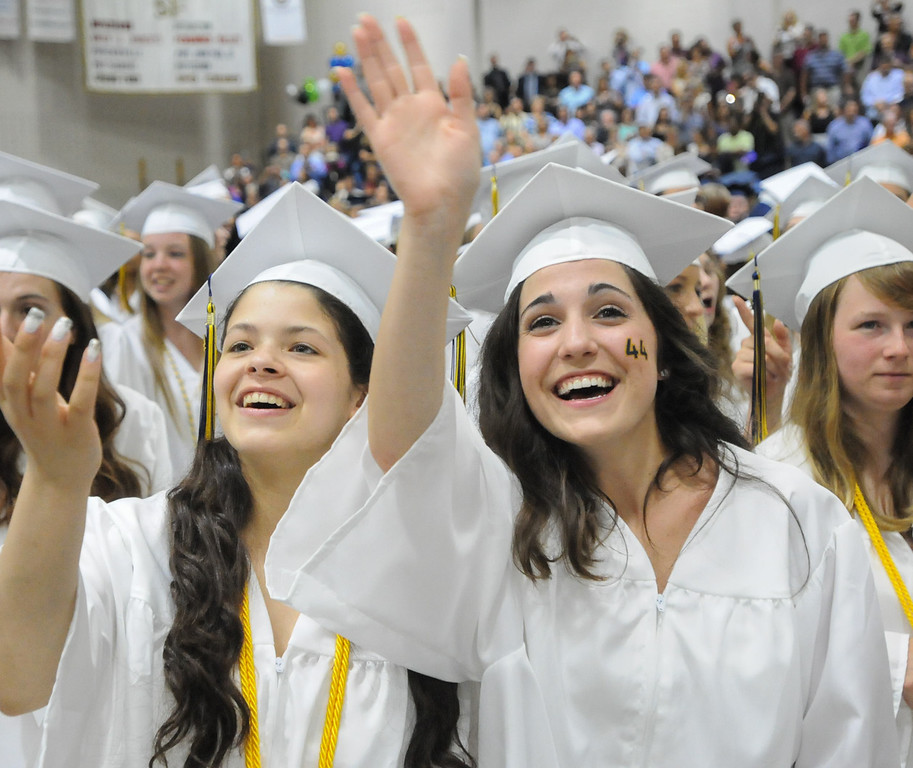 Description of . Andrea Erwin and and Danielle Emes wave out to family at the start of the Spring-Ford High School Class of 2014 commencement exercises Thursday June 12, 2014. Photo by John Strickler The Mercury