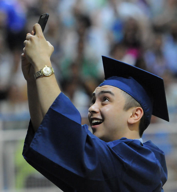 Description of . As Spring-Ford High School Class of 2014 president was finishing up his speech he turned around standing at the podium and snapped a 'selfie' with his classmates in the background, another first for a graduating class. Photo by John Strickler The Mercury