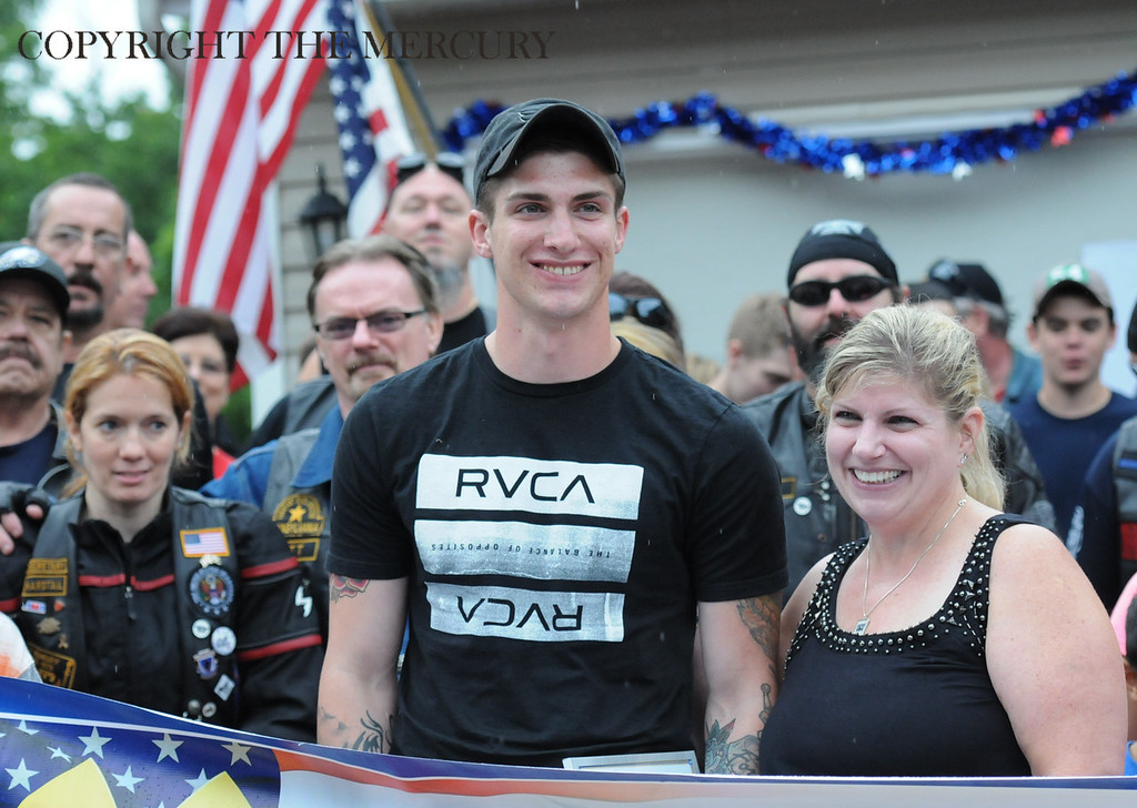 Description of . U.S. Army PFC Jake Spear center with his mother Ann Spear is all smiles during his homecoming after his deployment overseas. Warriors Watch Riders and Hogs and Heroes Foundation and A Hero's Welcome lead the way as they escorted him from the Phila. Airport. Lazer Limo provided a free ride home for Spear.Photo by John Strickler The Mercury
