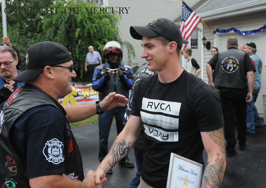 Description of . U.S. Army PFC Jake Spear is welcomed home after his deployment overseas. Warriors Watch Riders and Hogs and Heroes Foundation and A Hero's Welcome lead the way as they escorted him from the Phila. Airport. Lazer Limo provided a free ride home for Spear.Photo by John Strickler The Mercury