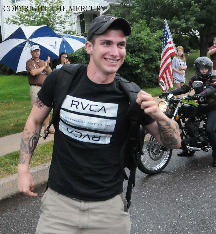 Description of . U.S. Army PFC Jake Spear is all smiles during his homecoming after his deployment oversea. Warriors Watch Riders and Hogs and Heroes Foundation and A Hero's Welcome lead the way as they escorted him from the Phila. Airport. Lazer Limo provided a free ride home for Spear.Photo by John Strickler The Mercury