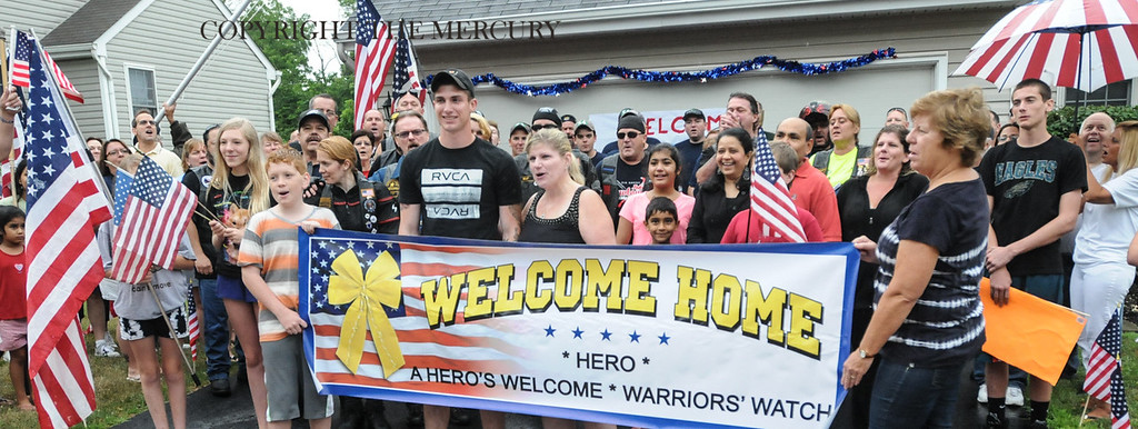 Description of . U.S. Army PFC Jake Spear is all smiles during his homecoming after his deployment overseas. Warriors Watch Riders and Hogs and Heroes Foundation and A Hero's Welcome lead the way as they escorted him from the Phila. Airport. Lazer Limo provided a free ride home for Spear.Photo by John Strickler The Mercury