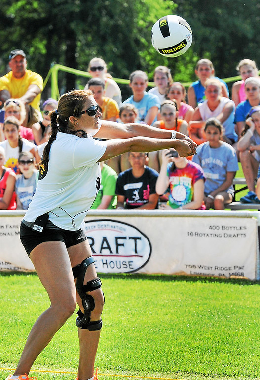 Description of . Olympic gold medalist Misty May-Treanor passes a ball during a volleyball clinic demonstration at Memorial Park in Pottstown Thursday morning.  (Photo by John Strickler/The Mercury)
