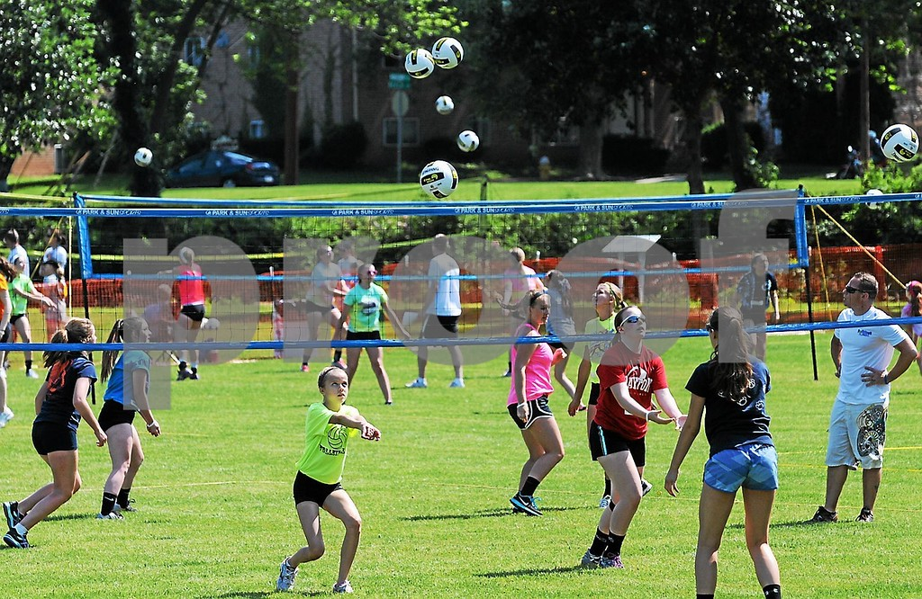 Description of . Children of all ages participate in a volleyball clinic sponsored by Spalding at Pottstown's Memorial Park. The clinic was held ahead of the annual Volleyball Rumble planned in the park this weekend, June 21-23. (Photo by John Strickler/The Mercury)