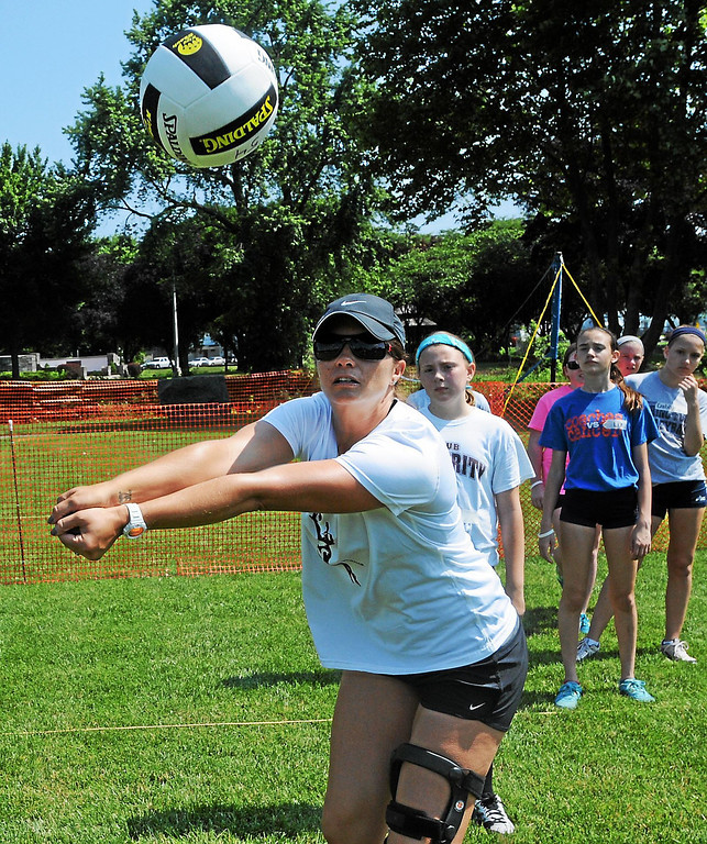 Description of . Misty May-Treanor shows how to properly pass the volleyball during a youth clinic. ?(Photo by John Strickler/The Mercury)