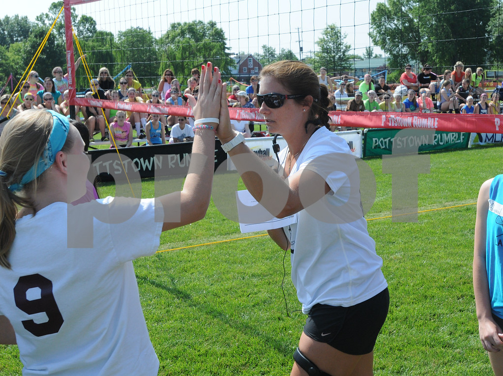 Description of . Misty May-Treanor high-fives a Dream in Gold Clinic participant. (Photo by John Strickler/The Mercury)