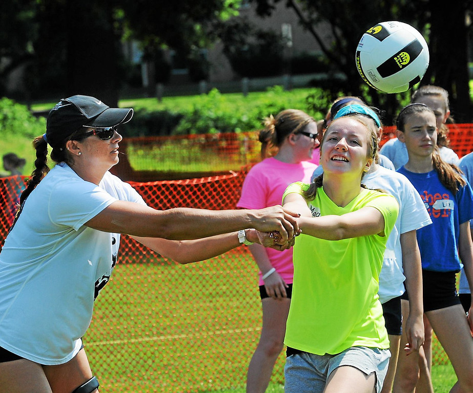 Description of . Maddy Lewis gets volleyball instruction from Olympic gold medalist Misty May-Treanor during the youth clinic held Thursday in Pottstown's Memorial Park. (Photo by John Strickler/The Mercury)