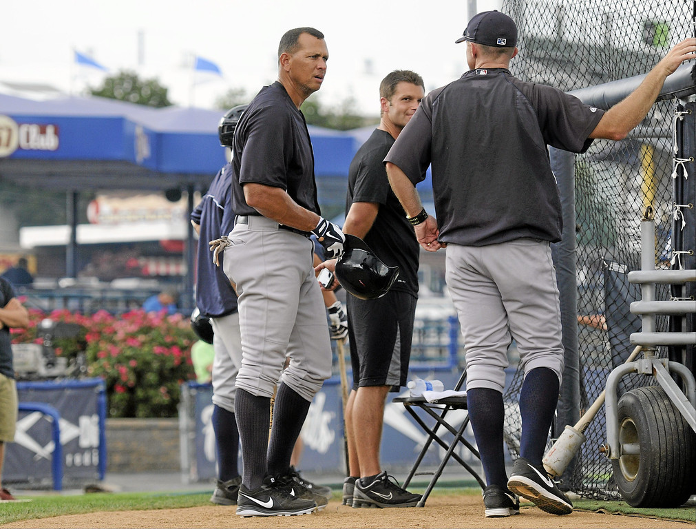 Description of . New York Yankees' Alex Rodriguez, left, during pregame warmups for a Class AA baseball game with the Trenton Thunder against the Reading Phillies, Monday, July 15, 2013, in Reading, Pa. Rodriguez is doing a rehab assignment with the Thunder recuperating from hip surgery. (AP Photo/Reading Eagle, Jeremy Drey)