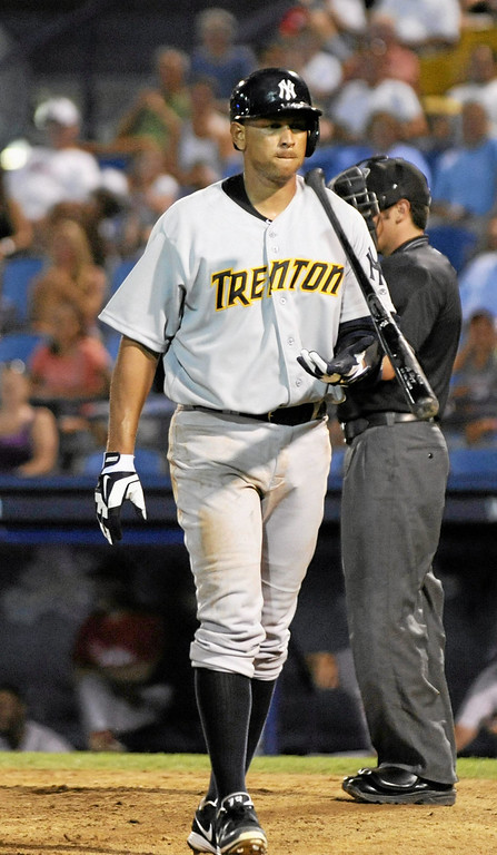 Description of . New York Yankees' Alex Rodriguez flips his bat after striking out in the seventh inning of a Class AA baseball game with the Trenton Thunder against the Reading Phillies, Monday, July 15, 2013, in Reading, Pa. Rodriguez is doing a rehab assignment with the Thunder recuperating from hip surgery. (AP Photo/Bradley C Bower)