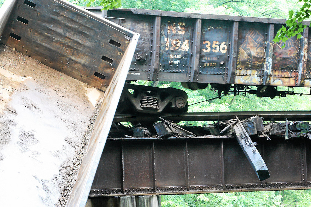 Description of . Two cars lay off a bridge into the Brandywine Creek following a train derailment in Valley, Chester County, on Monday, July 8, 2013.