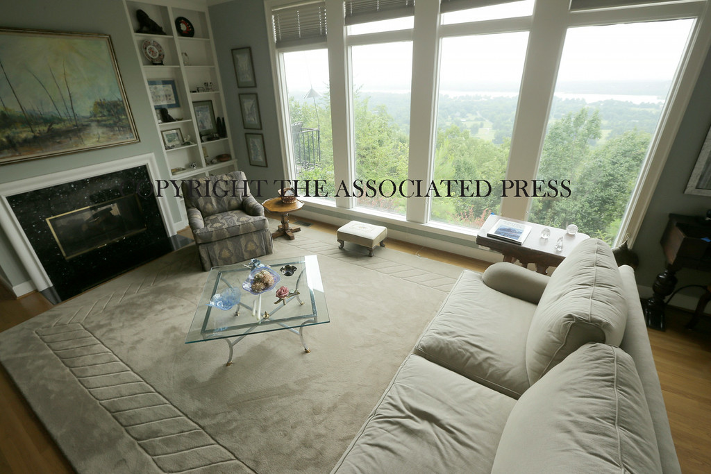 Description of . This is an interior view of the living room at a home for sale listed at $999,500 that is located on 5 acres of land overlooking the Arkansas River valley on Wednesday, July 30, 2014, in Little Rock, Ark. (AP Photo/Danny Johnston)