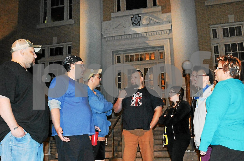 Description of . Kristopher Crater, second from left, talks to actors who would like to participate in the upcoming 'Temple of Terror' haunted house entertainment at the Stichter Lodge in Pottstown. (Photo by John Strickler / The Mercury)