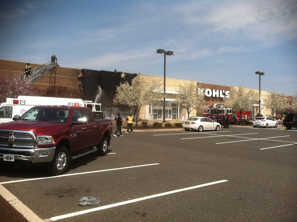 Description of . Fire damages the facade of the Kohl's Department Store in Limerick, Pa., on Friday, April 25, 2014. (Photo by John Grayshaw)