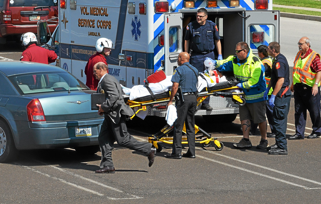 Description of . A person injured in a shooting in Montgomery Township is moved from an ambulance to a medical helicopter Monday,  June 2, 2014.  (Photo by Geoff Patton/The Reporter)
