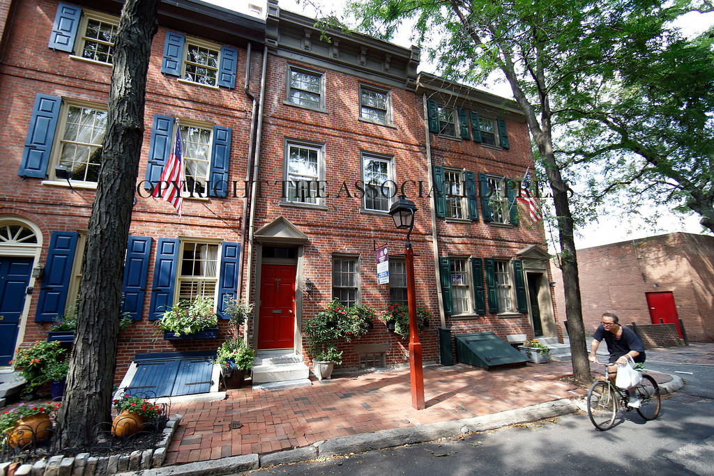 Description of . A row house on a tree-shaded street is for sale and is listed at $995,000 in the Society Hill neighborhood of Philadelphia on Wednesday, July 30, 2014. The 3,200-square-foot home includes four bedrooms, three full and two partial bathrooms and a year of pre-paid garage parking. (AP Photo/Matt Slocum)