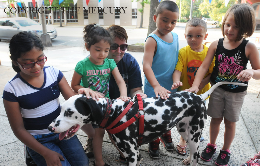 Description of . Allison Smale center with Goodwill Fire Co. with her dalmatian 'Maverick' as children pet the dog. Goodwill participated with First United Methodist Church on High St. as part of the National Night Out events in Pottstown. Photo by John Strickler The Mercury