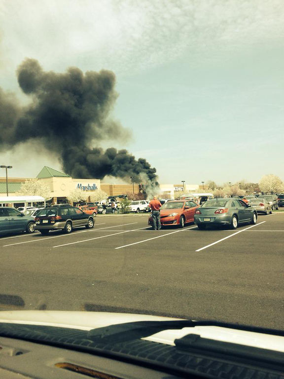 Description of . Smoke billows from the Kohl's Department Store off Township Line Road in Limerick, Pa., on Friday, April 25, 2014. (Photo by Troy Brandon Minner)
