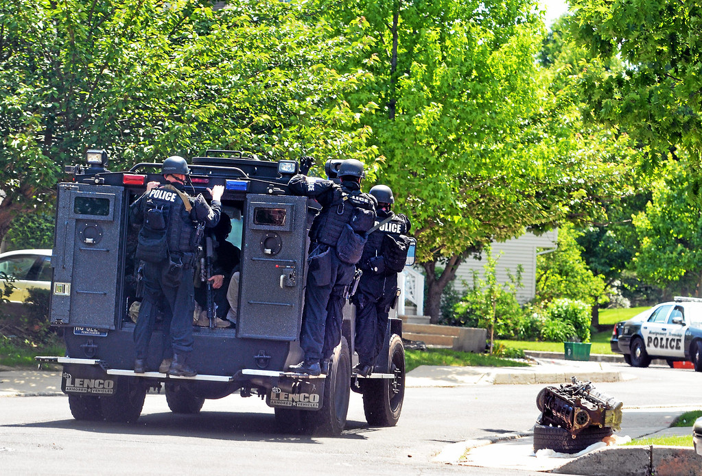 Description of . Members of a Central Montgomery County tactical response team travel on Harvard Drive following a shooting in Montgomery Township Monday, June 2, 2014. (Photo by Geoff Patton/The Reporter)