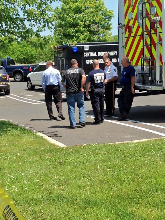 Description of . Authorities from area police departments and EMS wait near the scene of a shooting in Montgomery Township Monday, June 2, 2014. (Photo by Michael Alan Goldberg/The Reporter)