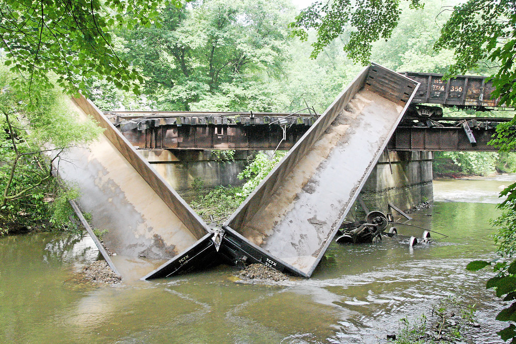 Description of . Two cars go off a bridge into the Brandywine Creek following a train derailment in Valley, Chester County, on Monday, July 8, 2013.