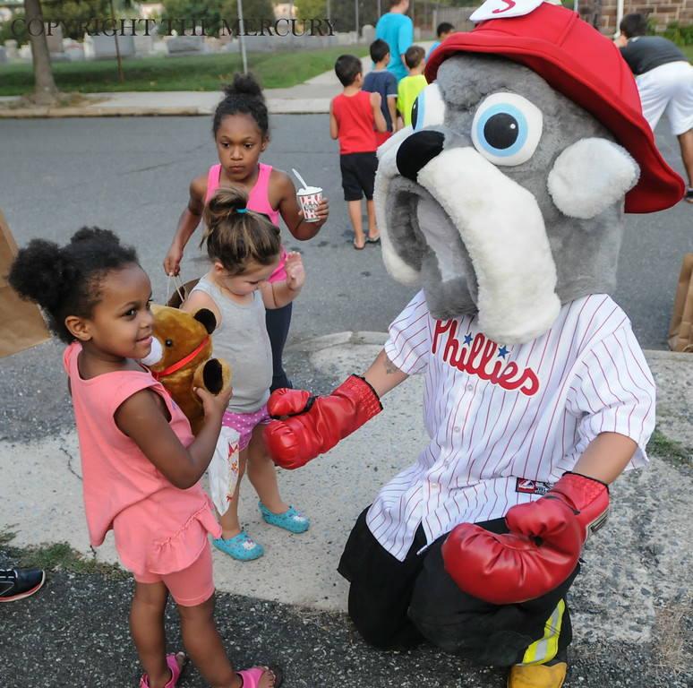 Description of . Kids visit with Phillies Fire Co. mascot Fire plug at First Church of the Brethren at Fifth and York street as part of the National Night Out events held in Pottstown. Photo by John Strickler The Mercury