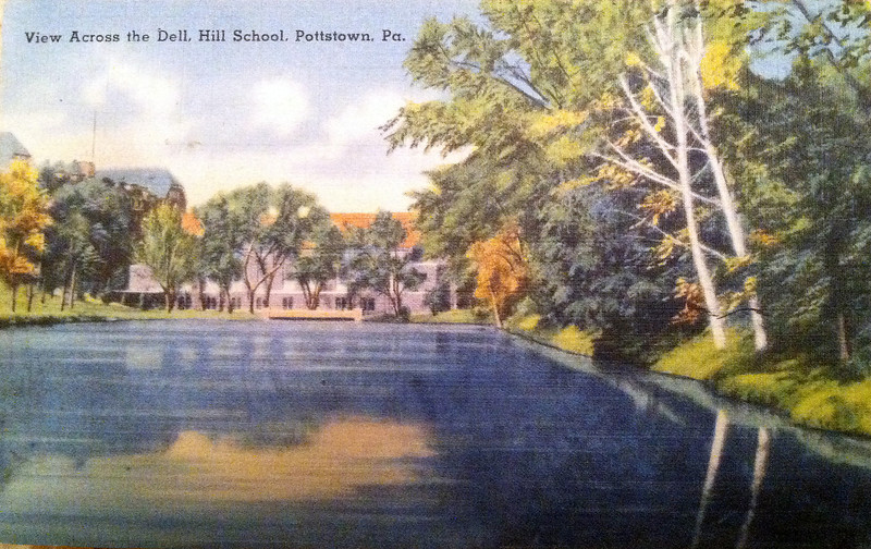 A postcard showing The Dell at the Hill School in Pottstown, Pa. There was no message written on the back. The large pond at the Hill School still exists and students jump into it after their graduation ceremony.