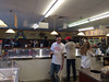 A film crew sets up scenes inside Nelson's Ice Cream store in Royersford. M. Night Shyamalan can be seen in the red baseball cap. (Photo by Amanda Nelson)
