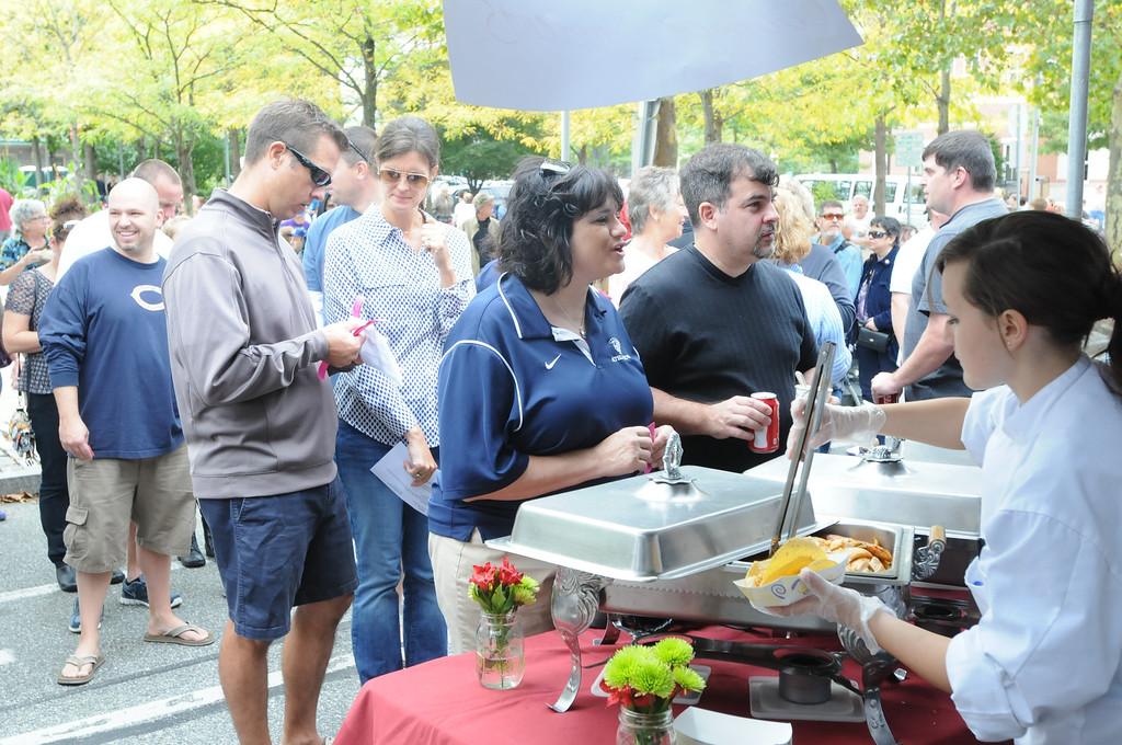 . Area residents were at the Carousel of Flavor to taste samples prepared by area restaurants and catering companies Sunday in downtown Pottstown along High St. Photo by John Strickler/The Mercury