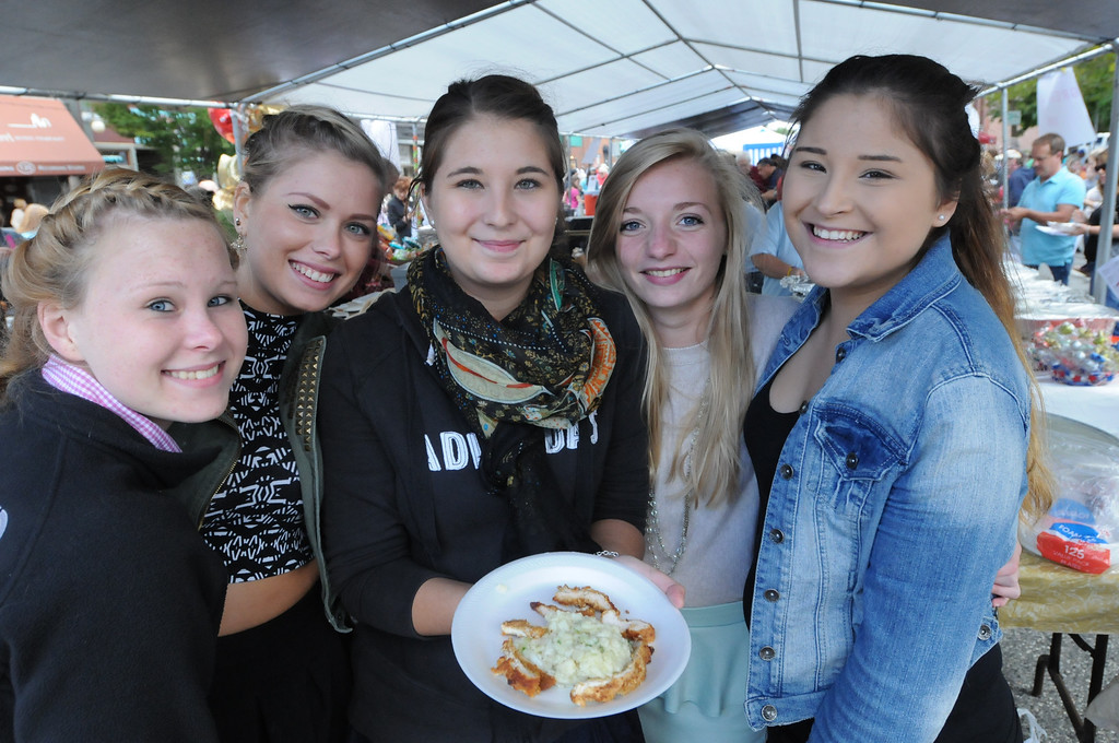 . Ala\'s Restaurant staff serves were on hand serving a variety of food to customers at the Carousel of Flavor on Sunday. Photo by John Strickler/The Mercury