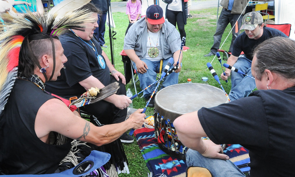 . Medicine Horse Singers and Dancers  drum during Native American pow wow held Saturday at Memorial Park. Photo by John Strickler The Mercury