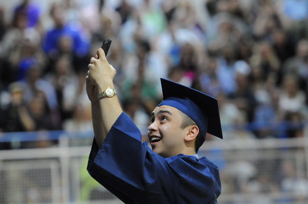 . As Spring-Ford High School Class of 2014 president was finishing up his speech he turned around standing at the podium and snapped a \'selfie\' with his classmates in the background, another first for a graduating class. Photo by John Strickler The Mercury