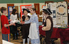 """Fifth-graders from Evergreen Elementary School in Collegeville acted as travel agents for the New World during the school's eighth annual Colonial Expo representing the 13 English colonies. Visitors were greeted by the student travel agents who encouraged the """"potential colonists"""" to book a trip for passage to their colony. Students also created colorful visual displays and pamphlets, dressed in colonial garb and displayed items that were relevant to the colony's economy such as peaches, cotton and rice <br /> <br /> Kevin Beattie, Emily Hinz, and Dillon VanGilder try to """"sell"""" one of their fellow students on the benefits of living in Virginia.<br /> <br /> Submitted by Perk Valley School District"""