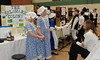 """Fifth-graders from Evergreen Elementary School in Collegeville acted as travel agents for the New World during the school's eighth annual Colonial Expo representing the 13 English colonies. Visitors were greeted by the student travel agents who encouraged the """"potential colonists"""" to book a trip for passage to their colony. Students also created colorful visual displays and pamphlets, dressed in colonial garb and displayed items that were relevant to the colony's economy such as peaches, cotton and rice <br /> <br /> Sophia Annis and Lillian Miller present to a visitor on the benefits of the Delaware Colony.<br /> <br /> Submitted by Perk Valley School District"""